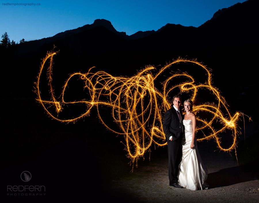 Bride and Groom with Sparklers at Silvertip Resort in Canmore, Alberta