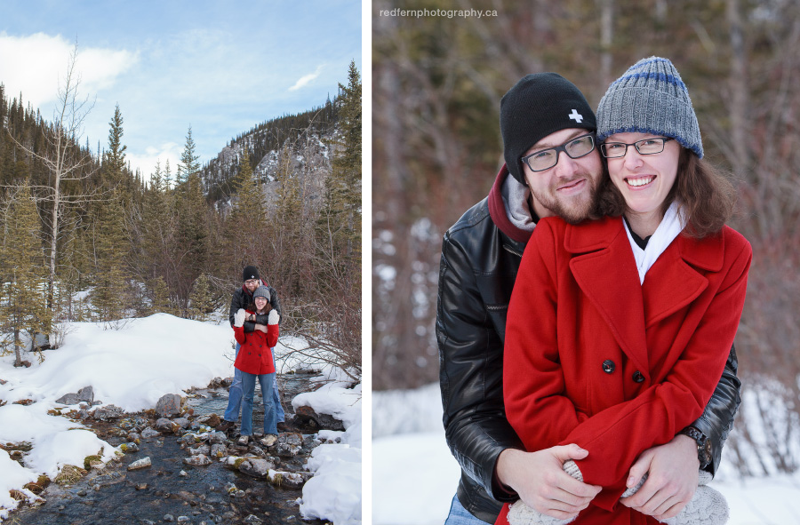 Engaged couple in winter clothing beside a creek in Canmore Alberta