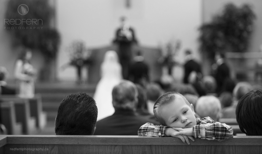 Bored little boy at a Calgary wedding ceremony