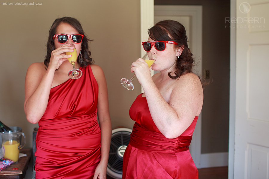 2_bridesmaids_red_dresses_sunglasses