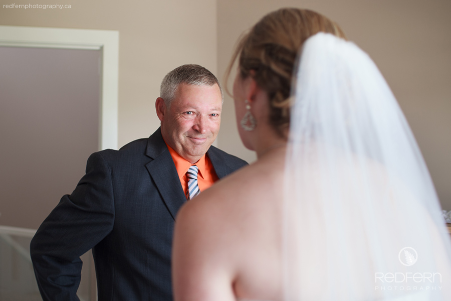 Tearful father looking at bride
