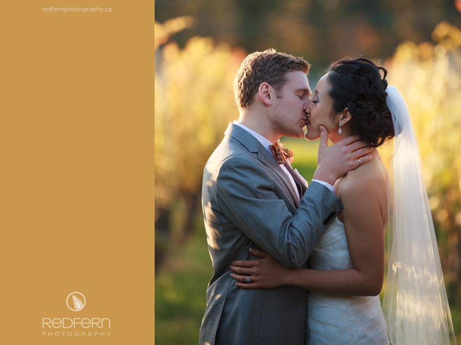 13_kelowna_wedding_vineyard_autumn_leaves_kiss