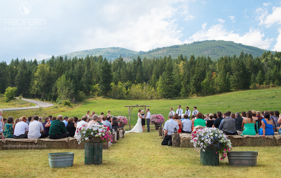 bride walking down aisle with parents outdoor wedding