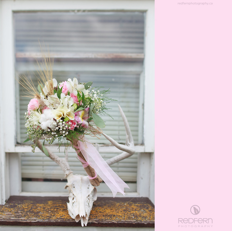pink wedding bouquet with antlers deer