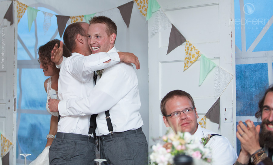 the groom and best man hugging after his toast