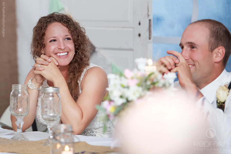 laughing bride and groom wedding reception