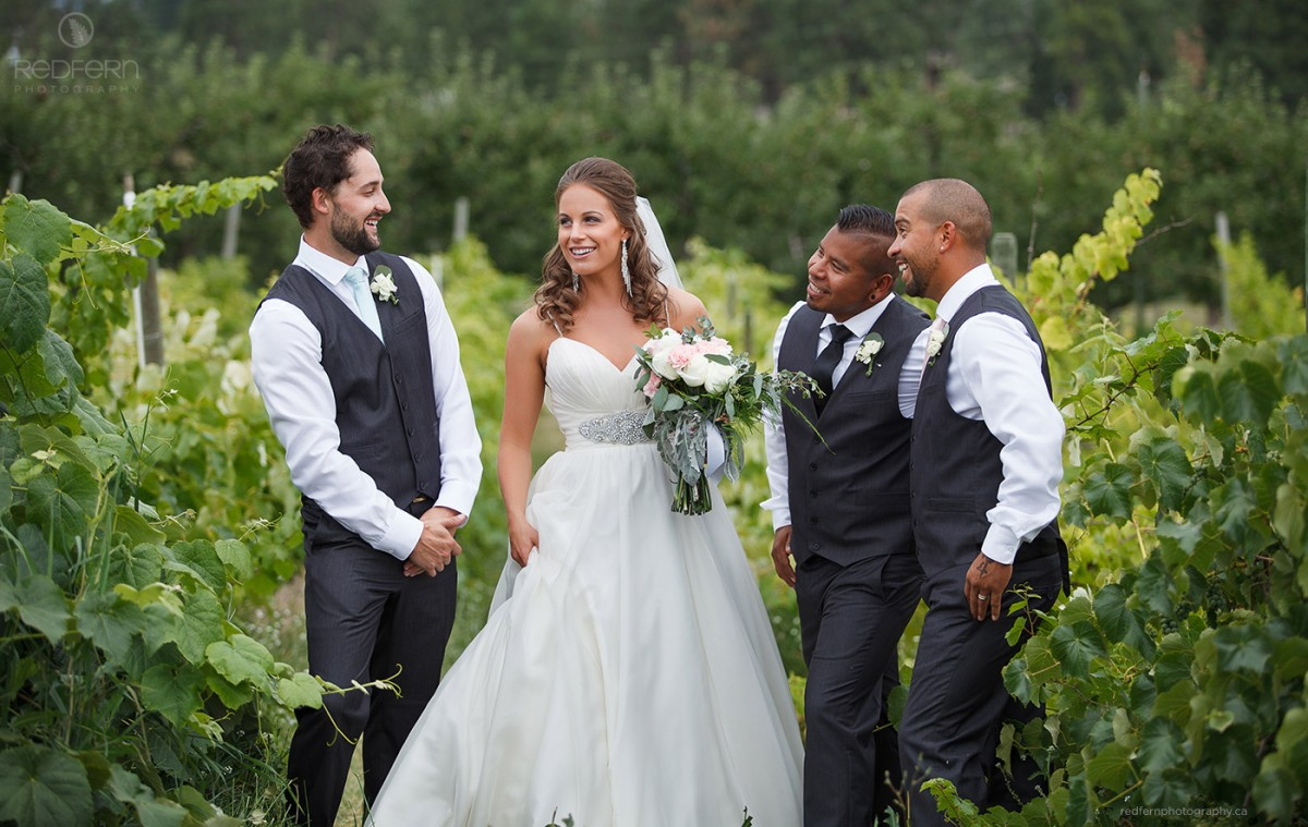 okanagan bride with groomsmen pictures in the vineyard vines